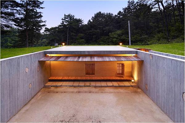 Casa Tierra: Arquitectura enterrada como homenaje a la naturaleza