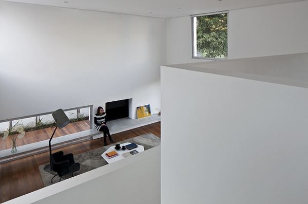 Double-height living room space view from staircase