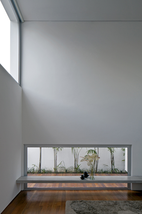 Double-height living space showing the low window looking at lat