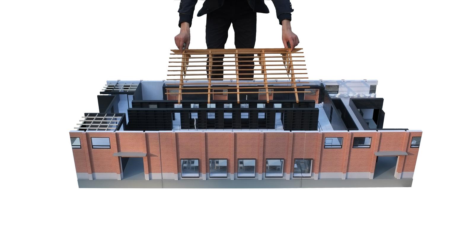 TAO revitaliza un antiguo almacén de Pekín a base de acero y osadía